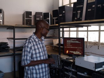 Zambian technician tests computers when they arrive in Africa