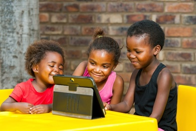 Young African girls using tablet